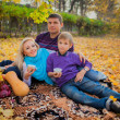 Family having  picnic in the park — Stock Photo