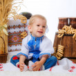 Boy  with bagels and traditional props — Stock Photo