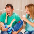 Happy family playing with their child — Stock Photo