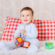 Blue-eyed boy plays cubes — Stock Photo