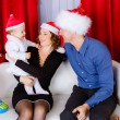 Stock Photo: Happy family in Christmas hats