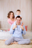 Happy family on the bed — Stock Photo
