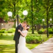 Bride and groom in park — Photo