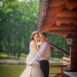 Bridal couple porch of a wooden house — Foto de Stock