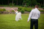 Wedding couple playing football — Stock Photo