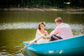 Wedding couple in the boat — Stock Photo