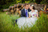 Groom and bride in the woods with a fruit basket — Stock Photo