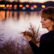 Girl near the river in autumn evening — Stock Photo #36214985