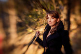 Girl in autumn blurred background — Stock fotografie