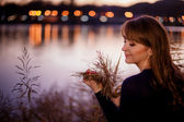 Girl near the river in autumn evening — Stock Photo