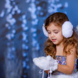 Girl in white warm gloves and headphones playing with snow  — ストック写真