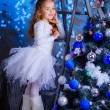 Little girl decorating the Christmas tree. — Stock Photo #36282163