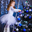Little girl decorating the Christmas tree. — Stock Photo #36282167