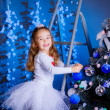 Little girl decorating the Christmas tree. — Stock Photo #36282169