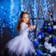 Little girl decorating the Christmas tree. — Stok Fotoğraf #36282183