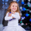 Girl with decorative toy balls on Christmas — Stock Photo