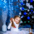 Little girl played with cones on New Year — Stock Photo