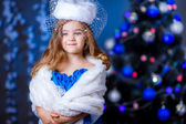 Little girl in princess dress with white hat — Stockfoto