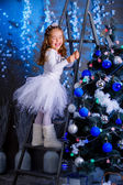 Little girl decorating the Christmas tree. — Stock Photo