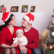 Happy family in Christmas hats — Foto Stock