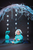 Little boy dressed as rabbit on winter scene — Stock Photo