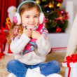 Stock Photo: Happy little girl near Christmas tree
