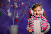 Happy little girl on Christmas background — Stock Photo