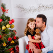 Dad and daughter with dog  near the Christmas tree — Stock Photo