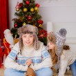 Kids playing with dog chihuahua near the Christmas tree — Stock Photo