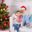 Stock Photo: Happy childrens near Christmas tree