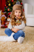 Little girl with a dog near the Christmas tree — Stock Photo
