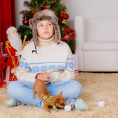Boy with chihuahua near a Christmas tree — Stock Photo
