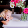 Stock Photo: Girl leaned on piano