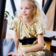 Little blond girl sitting on the table — Stock Photo #36704549