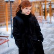 Beautiful girl walking in a fur coat — Стоковое фото