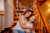 Mother and daughter hugging on the stairs — Стоковое фото