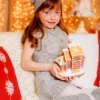 Red-haired girl with Christmas cake — Stock Photo