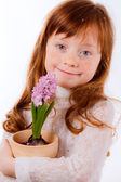 Cute red-haired girl with hyacinth — Стоковое фото