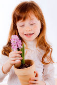 Cute red-haired girl with hyacinth — Foto Stock