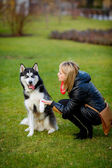 Dog giving paw to woman — Stock Photo