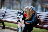 Woman hugging dog — Stok fotoğraf