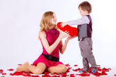 Brother giving to sister red heart — Stock Photo