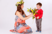 Son giving mother tulips — Stock Photo