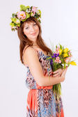 Woman in wreath with tulips — ストック写真