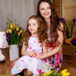 Smiling mother and daughter at home — Stock Photo