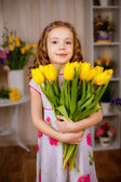 Charming girl with tulips — Stock Photo