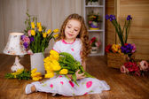 Girl with tulips at home — Foto Stock