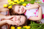 Mother and daughter with tulips — Stock Photo