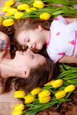 Happy mother and daughter with tulips — Stock Photo