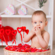 Little boy sits among candies — Stock Photo
